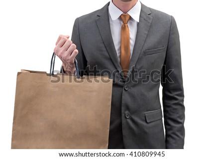 Businessman holding a shopping bag  isolated on white background. - stock photo