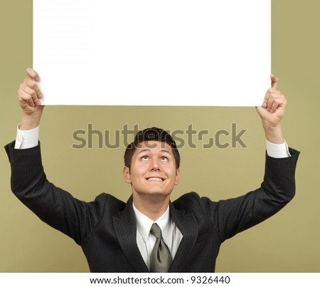 Businessman holding a sign that is easily expandable for copy and smiling - stock photo