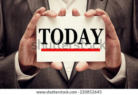 Businessman holding a signboard with the word Today - stock photo