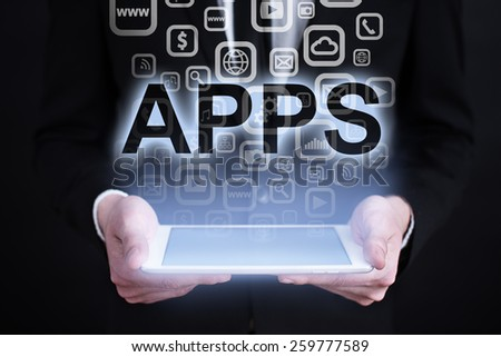 businessman holding a tablet pc with apps icons and text. Internet concept. business concept.  - stock photo