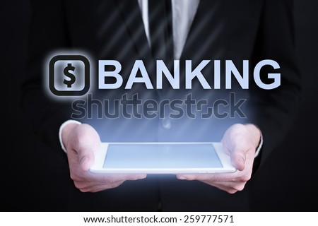 businessman holding a tablet pc with banking text. Internet concept. business concept.  - stock photo