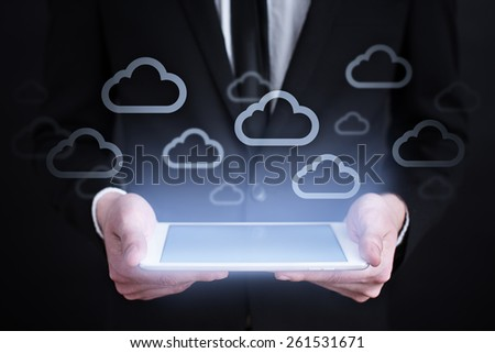 Businessman holding a tablet pc with cloud iconst on virtual screen . Internet concept. business concept. - stock photo