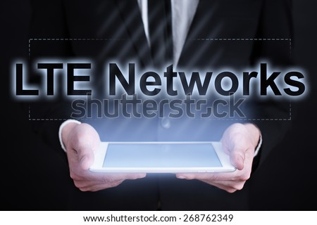 Businessman holding a tablet pc with LTE Networks text on virtual screen. Internet concept. Business concept. - stock photo
