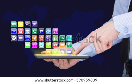 Businessman holding a tablet pc with mobile applications icons on virtual screen . Internet and business concept. - stock photo