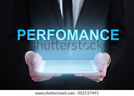 "Businessman holding a tablet pc with ""performance"" text on virtual screen. Business concept. Internet concept. - stock photo"