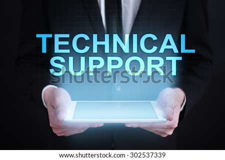 "Businessman holding a tablet pc with ""technical support"" text on virtual screen. Business concept. Internet concept. - stock photo"