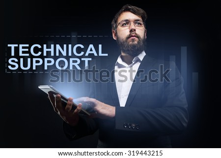 "Businessman holding a tablet pc with ""Technical support"" text on virtual screen. Business concept. - stock photo"
