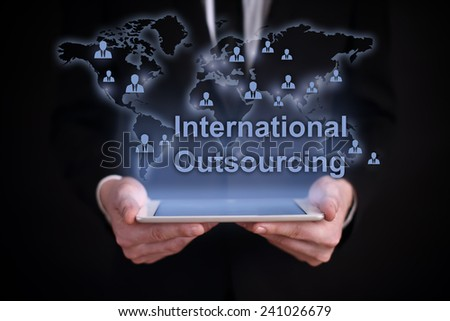 businessman holding a tablet PC with the projection map of the world on the screen. icons of people around the world. global recruitment. outsourcing. - stock photo
