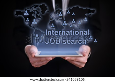 businessman holding a tablet PC with the projection map of the world on the screen. icons of people around the world. global recruitment. job search. - stock photo