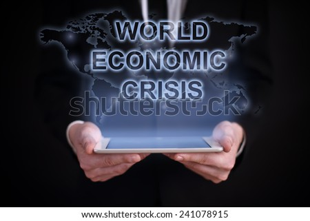 businessman holding a tablet PC with the projection map of the world on the screen. WORLD ECONOMIC CRISIS. global recruitment. job search. - stock photo