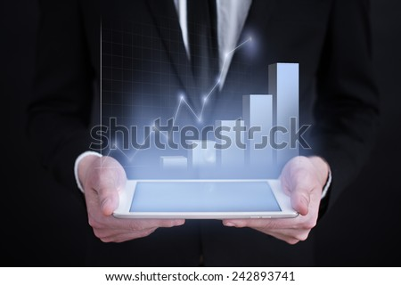 businessman holding a tablet PC with the projection of graph. investment concept.  financial growth. char. data analysis. statistics - stock photo