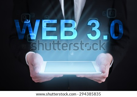 "Businessman holding a tablet pc with ""web 3.0"" text on virtual screen. Internet concept. development."