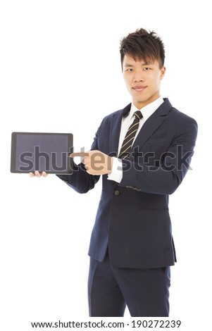 businessman holding a tablet to presenting - stock photo