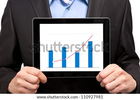 Businessman holding a tablet touch computer gadget with an insulated screen - stock photo