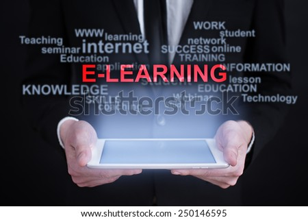 Businessman holding a tablet with e-learning words cloud on the screen. business and education concept - stock photo