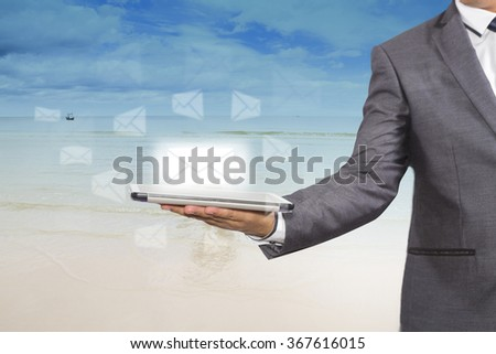 Businessman holding a tablet with email social network, Information and emails - stock photo