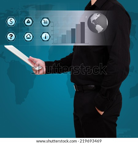 Businessman holding a tablet with globe and icon application on virtual screen. Concept of online business. - stock photo