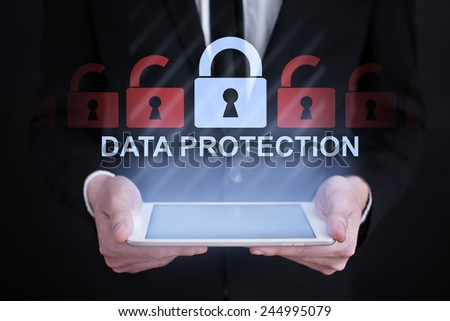 Businessman holding a tablet with internet security concept. information security. data security. - stock photo