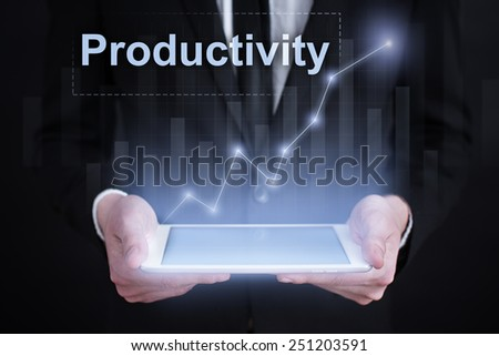 Businessman holding a tablet with productivity increase graph on the screen. business concept - stock photo