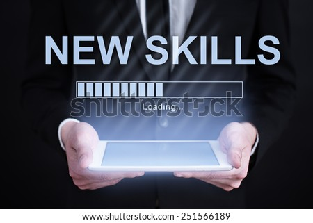 Businessman holding a tablet with teamwork concept on the screen. business concept. - stock photo