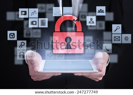 Businessman holding a tablet. with touch screen interface and cyber security concept . internet concept. - stock photo