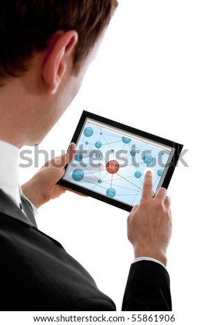 Businessman holding a touchpad pc and surfing in the social network, isolated on white - stock photo