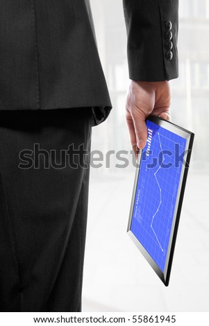Businessman holding a touchpad pc in his hand, showing the stock market - stock photo