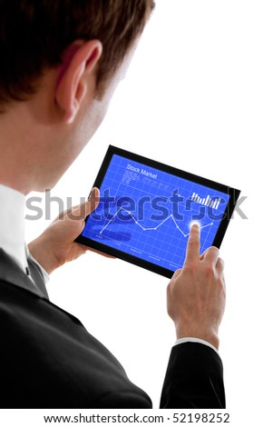 Businessman holding a touchpad pc, one finger touches the screen and checking the stock market, isolated on white