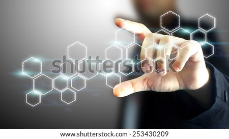 Businessman holding a touchscreen button. - stock photo
