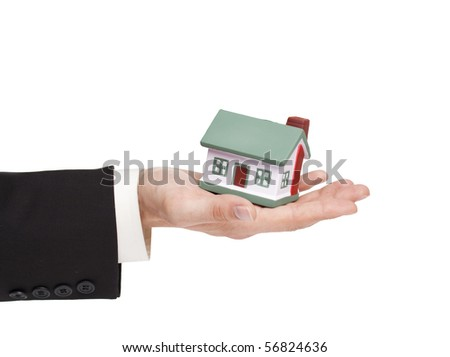 businessman holding a toy house, real estate presentation - stock photo