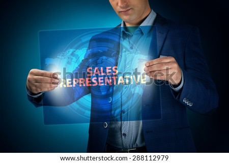 Businessman holding a transparent screen with an inscription a sales representative. Business, technology, internet and networking concept. - stock photo