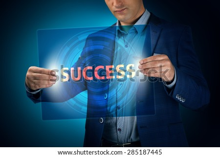 Businessman holding a transparent screen with an inscription a success. Business, technology, internet and networking concept. - stock photo