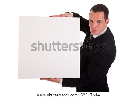 Businessman holding a white board, looking to camera, isolated on white background - stock photo