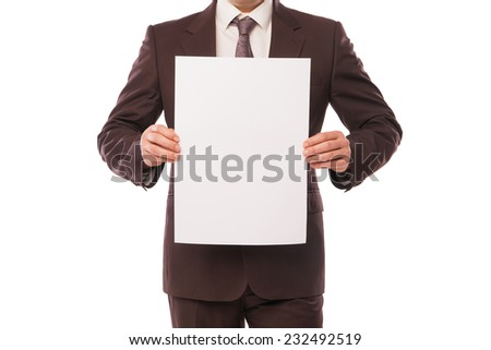 Businessman holding a white piece of paper with empty space for advertisement or information - stock photo