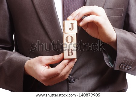 businessman holding a word job made of wooden blocks - stock photo