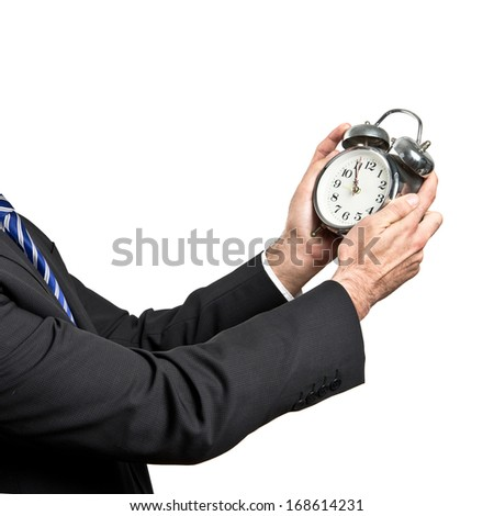 Businessman holding an antique clock over white background