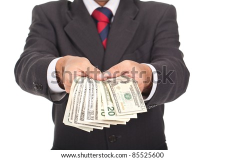 businessman holding and giving away dollar bills