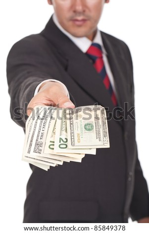 businessman holding and giving away dollar bills - stock photo