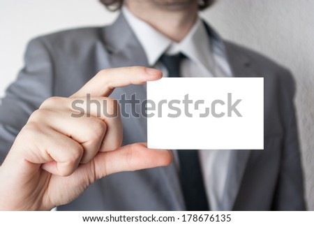 Businessman holding and showing an empty card