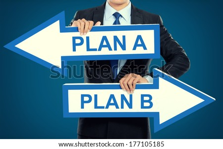 Businessman holding arrow in hand, Planning choices concept - stock photo