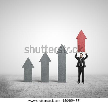 businessman holding arrows on white background - stock photo