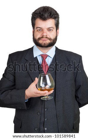 Businessman holding at a glass of whisky - stock photo