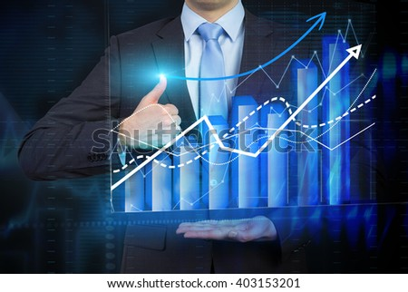 Businessman holding bar chart and graphs drawn on virtual screen, thumb raised up. Chest view. Concept of business analysis. - stock photo