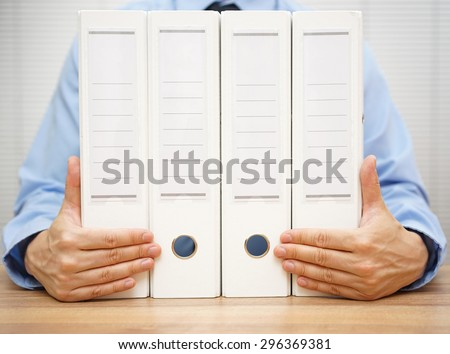 businessman holding binders.  accounting, finance or law concept - stock photo
