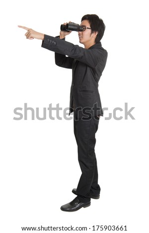 Businessman holding binocular