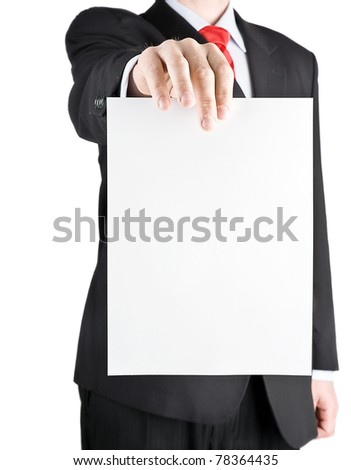 Businessman holding blank card - vertical view - stock photo