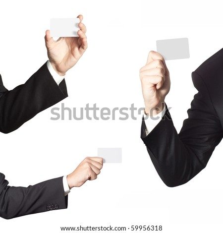 Businessman holding blank cards on white background