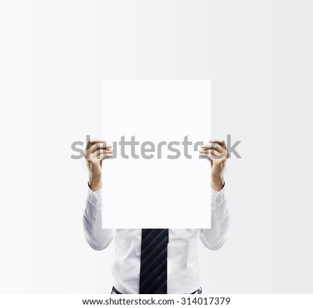 businessman holding blank paper card - stock photo