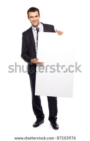 Businessman holding blank poster - stock photo