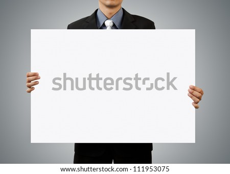 businessman holding blank sign - stock photo